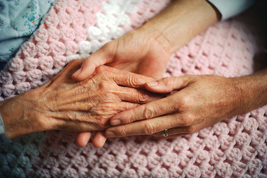Elderly hands holding each other
