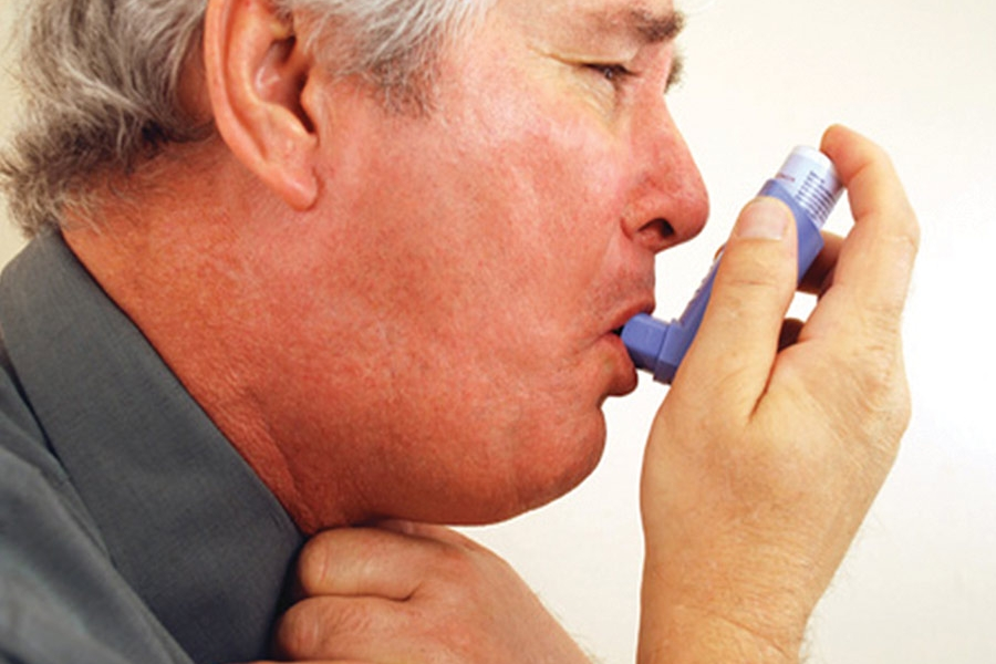 Asthma sufferer using puff