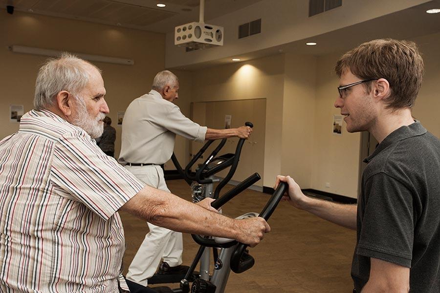 Elderly men on gym equipment