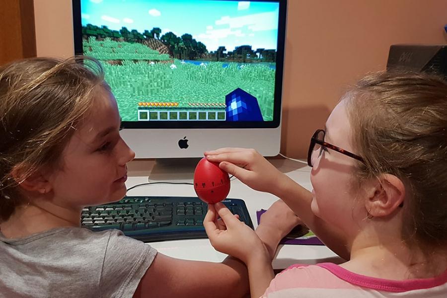 Girls playing Minecraft on desktop