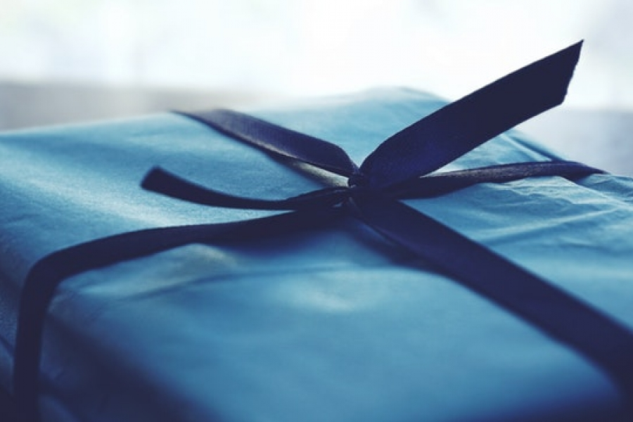 Boxed gift wrapped in blue