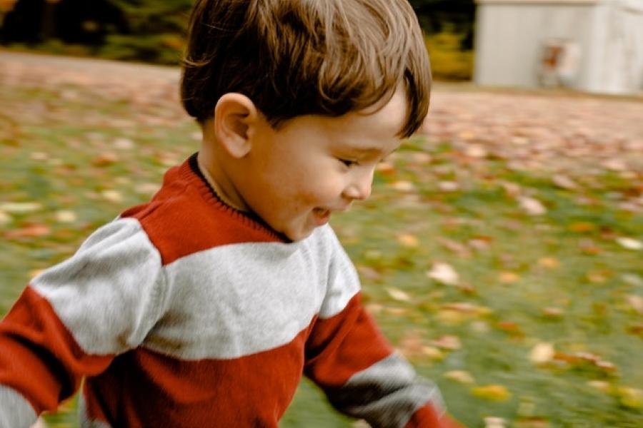 Toddler running on grass