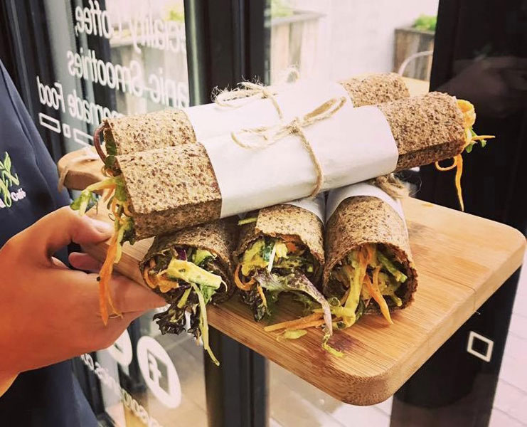 Image is of a serving board of healthy wraps