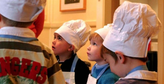 Image of kids paying attention during a cooking class