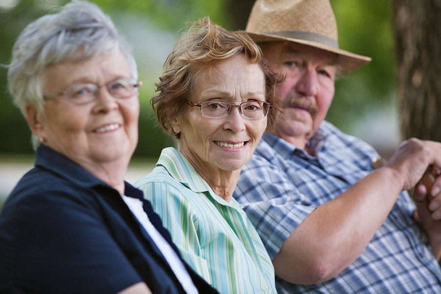 Row of smiling elderly folk