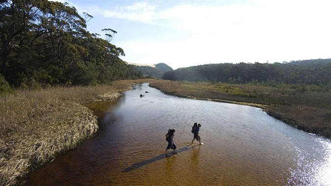 Image of a couple hiking across the Mitchell River National Park