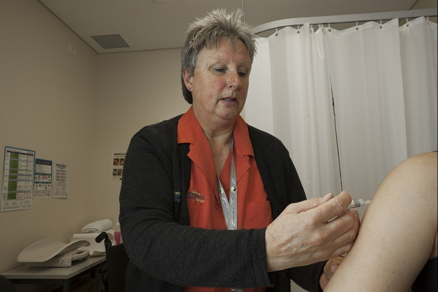 Nurse injecting patient's shoulder