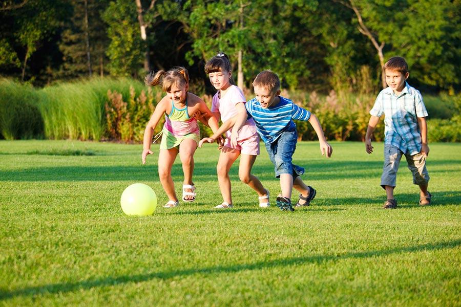 Kids chasing a ball