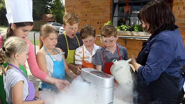 image of children undertaking a cooking class