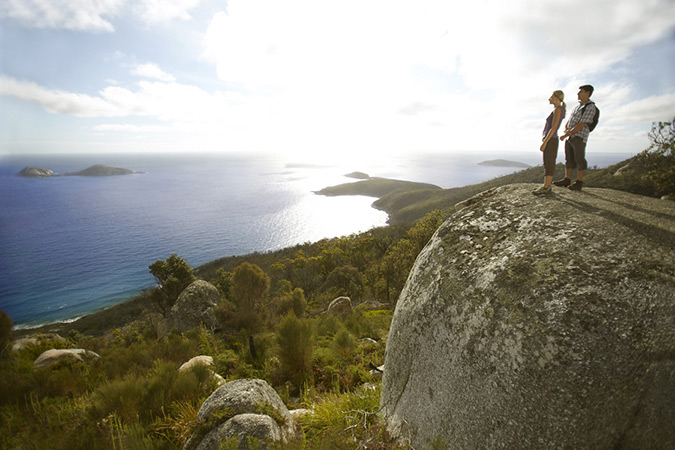 Image of a couple standing on top of Mt Oberon looking out over Wilsons Promontory