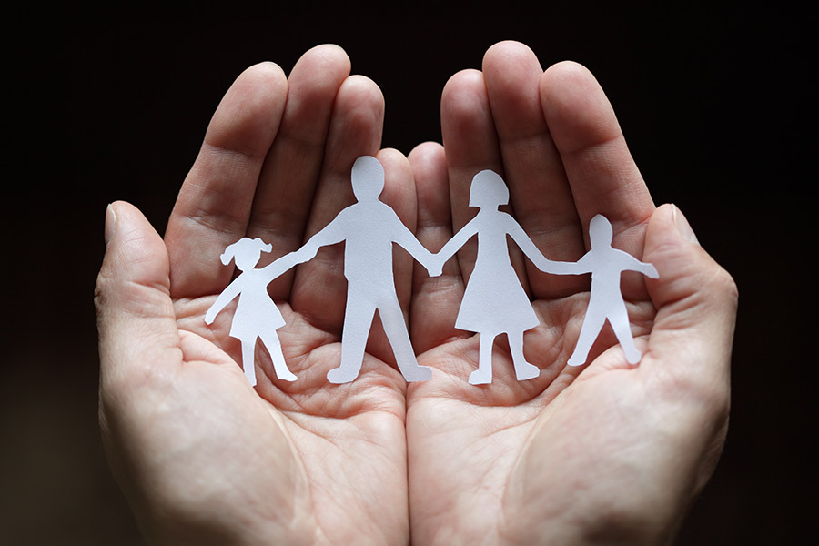 Palm holding cutout of family