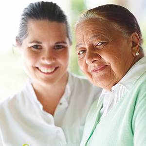 Smiling nurse and elderly