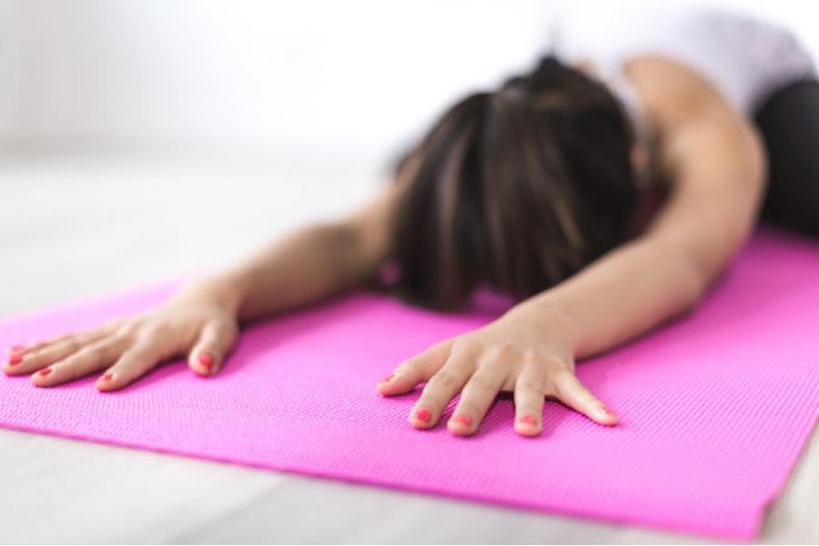 Woman on pink yoga mat