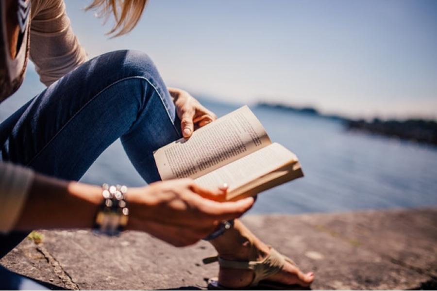 Woman reading on pier